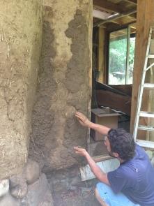 Cobbing the walls.